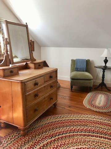 Antique pine dresser, Capel braided rugs in your light filled guest room.