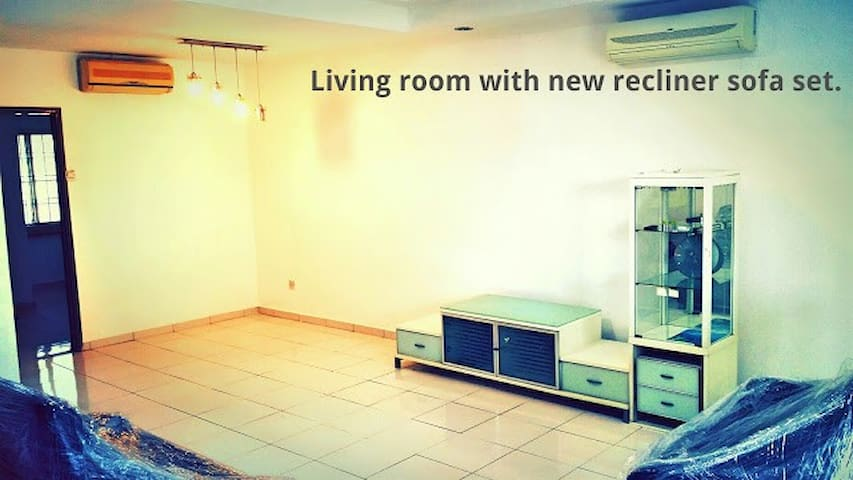 Spacious living room with 2 sets of Air conditioning.