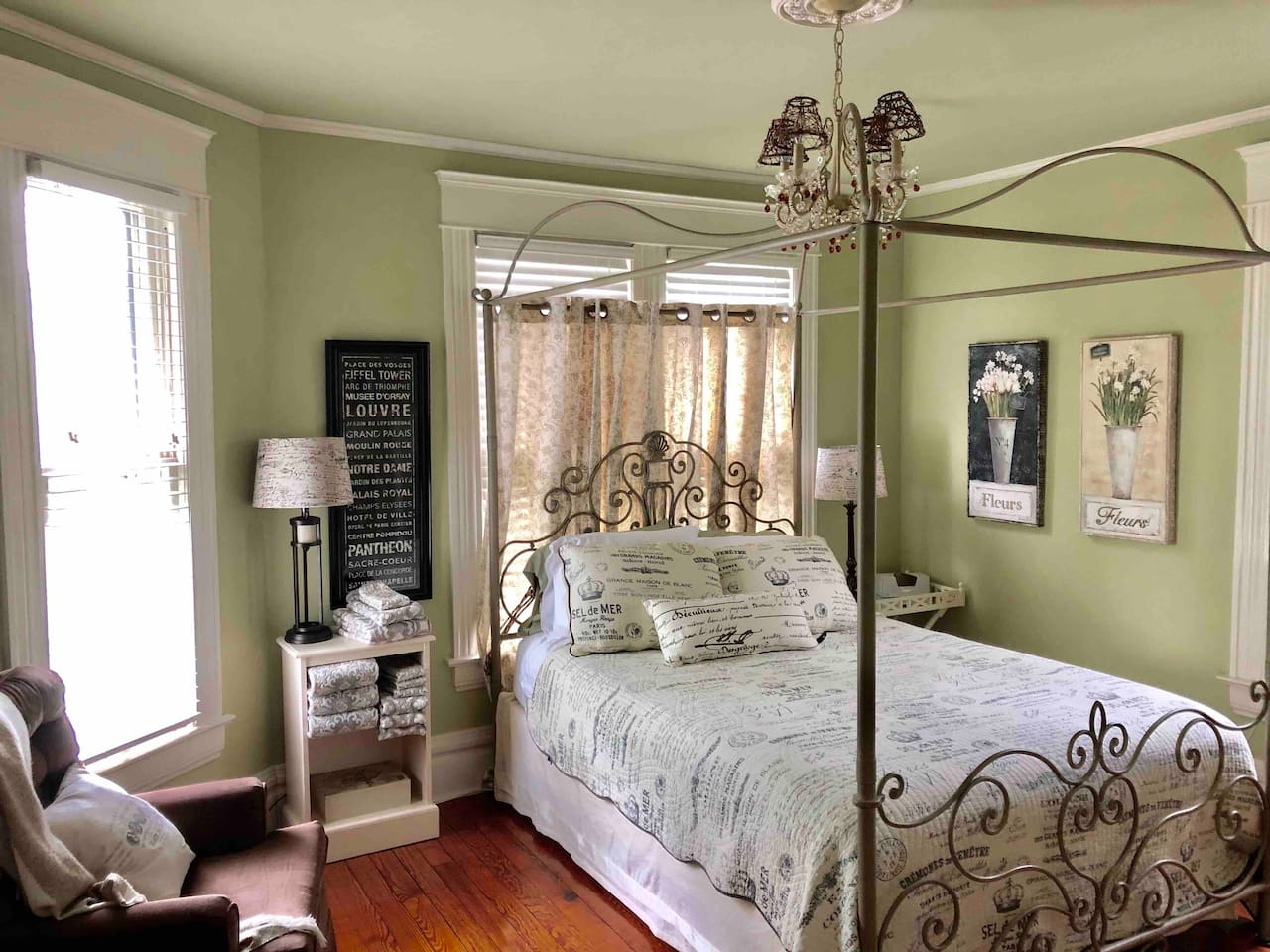 Enjoy the romantic Paris themed master bedroom with its comfortable queen size bed.  The room combines dramatic elements, like the canopy and chandelier, with tranquil, soothing colors and designs.