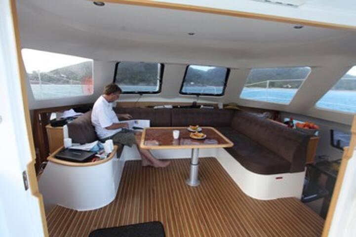 Amour de la Mer - a deluxe catamaran at berth