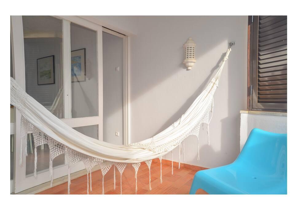 Varanda com cama de rede
