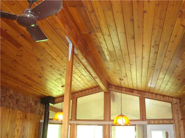 Vaulted cedar ceilings with floor to ceiling windows on east and west walls