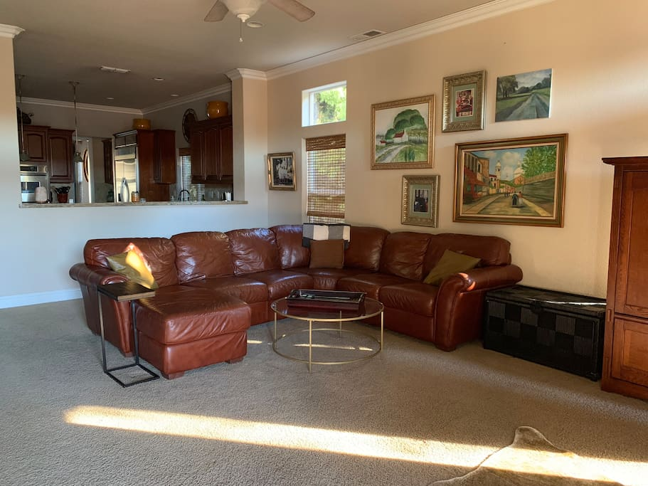 Sectional leather couch in family room Facing big screen tv