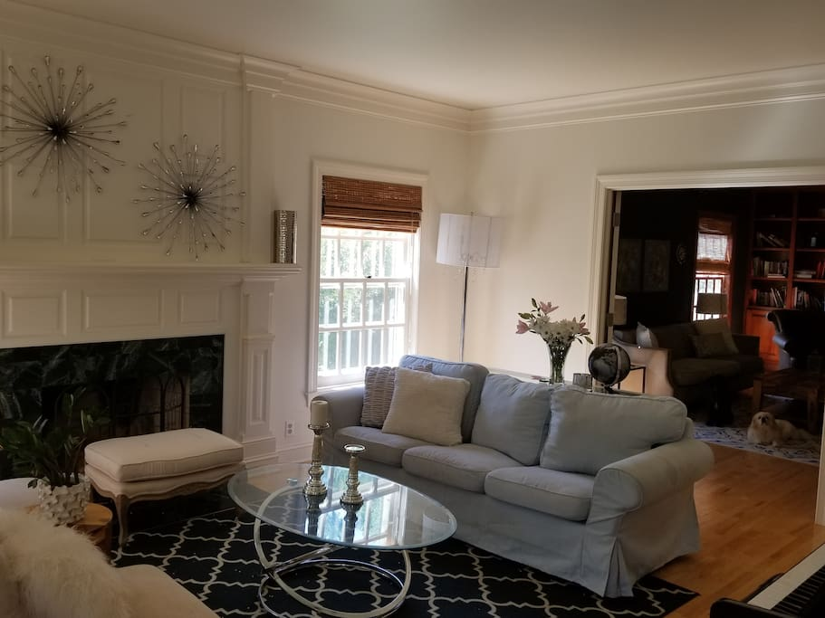 Front living room has French doors to den