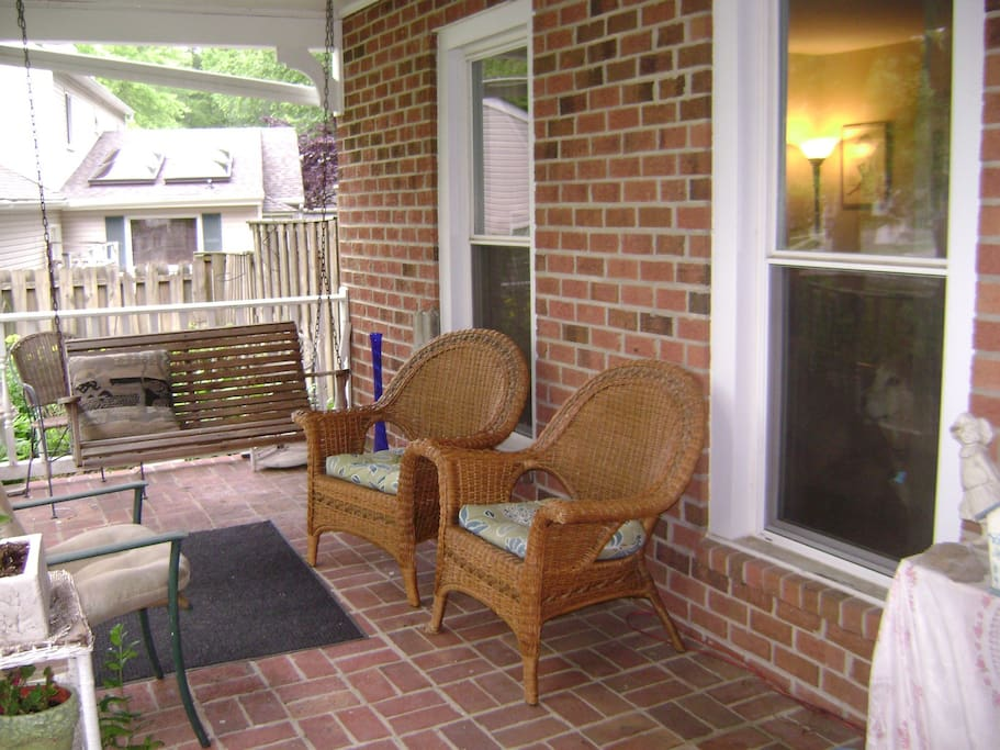 covered front porch with a swing