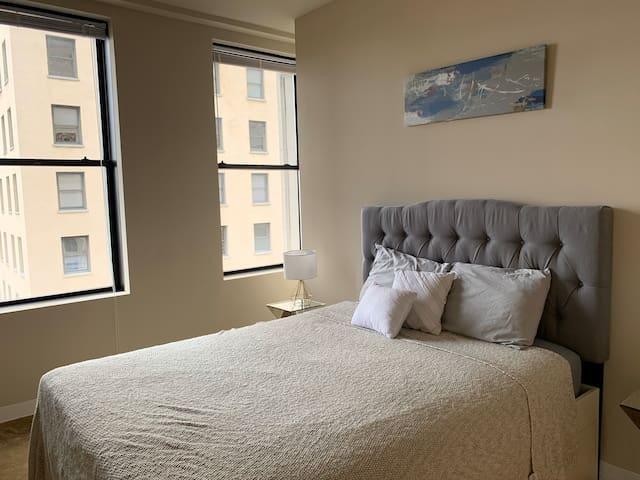 Master bedroom with comfy queen bed and en suite full baths