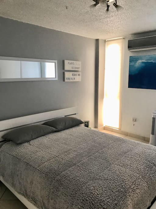 Air-conditioned Bedroom with comfortable Queen Size bed and Smart TV