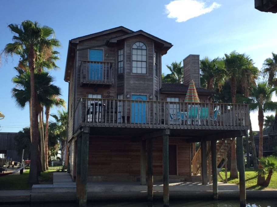 Pelican Way, 2 story canal home with lots of deck space up and down