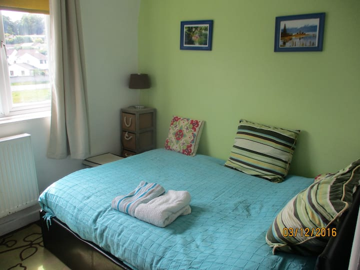 Truro double bedroom with a great view and a husky