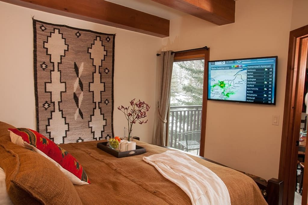 The master bedroom features a comfortable king or queen sized bed.