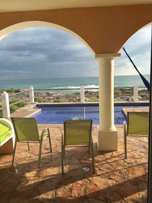 view from the kitchen. Large patio and pool. *upstairs unit also has access to the pool