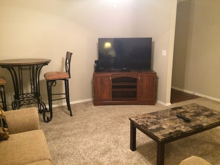 "Very comfortable Family  Room with sofa, love seat, coffee table, end tables, pub table w/pub chairs, lamps, and 50"" television"