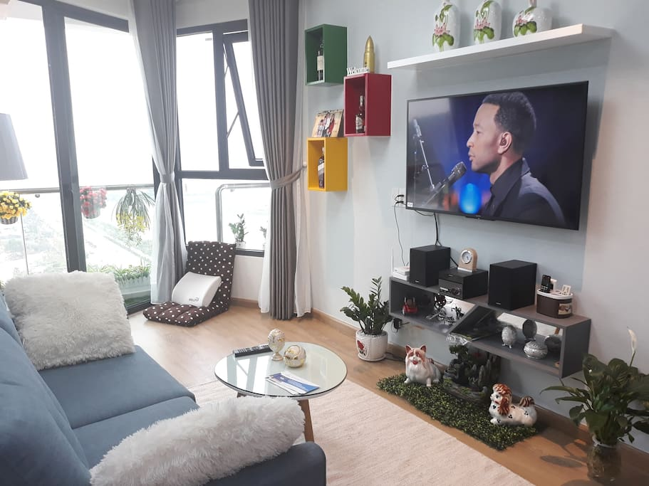 Modern and full furnished living room with smart TV