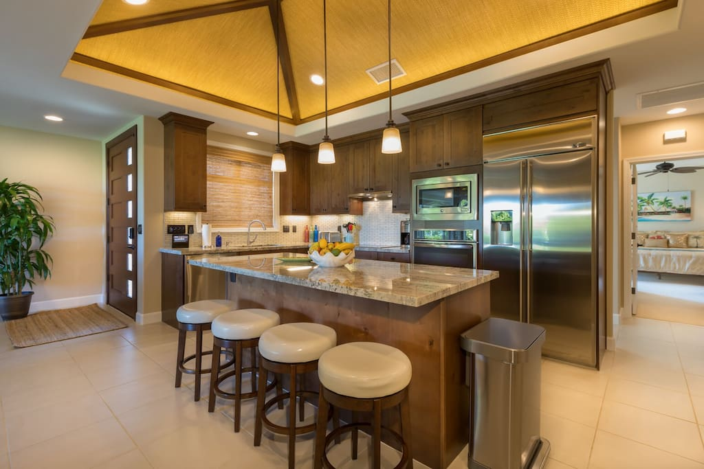 Gorgeous open kitchen with bar seating.