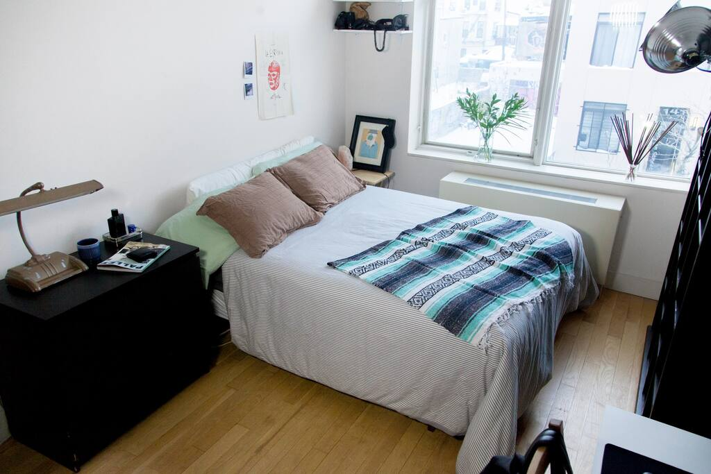 The bedroom, queens size bed, loads of light