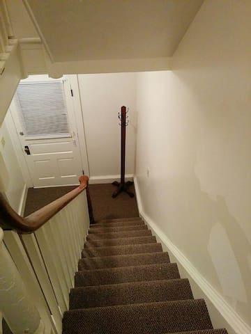 Looking down stairs toward front door.