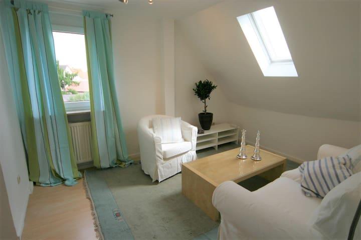 Charmante DG-Wohnung in Rüsselsheim-Königsstädten