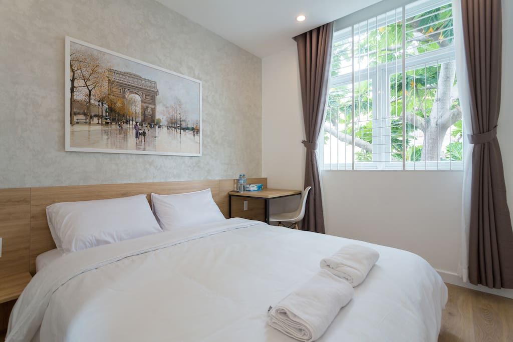 Your room with natural light, queen size bed, working desk, wardrobe, private fridge, private bathroom , clean beddings and towels