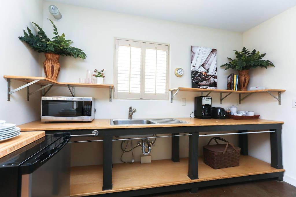 Not feeling like eating out? Cook a healthy home-cooked meal including a (not pictured here) hot plate, microwave, refrigerator, full set of knives, a set of pots and pans along with all the other kitchen essentials.