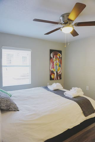The bedroom has its own separate A/C unit. You'll find the iron, ironing board, hair dryer and two luggage racks in the closet.
