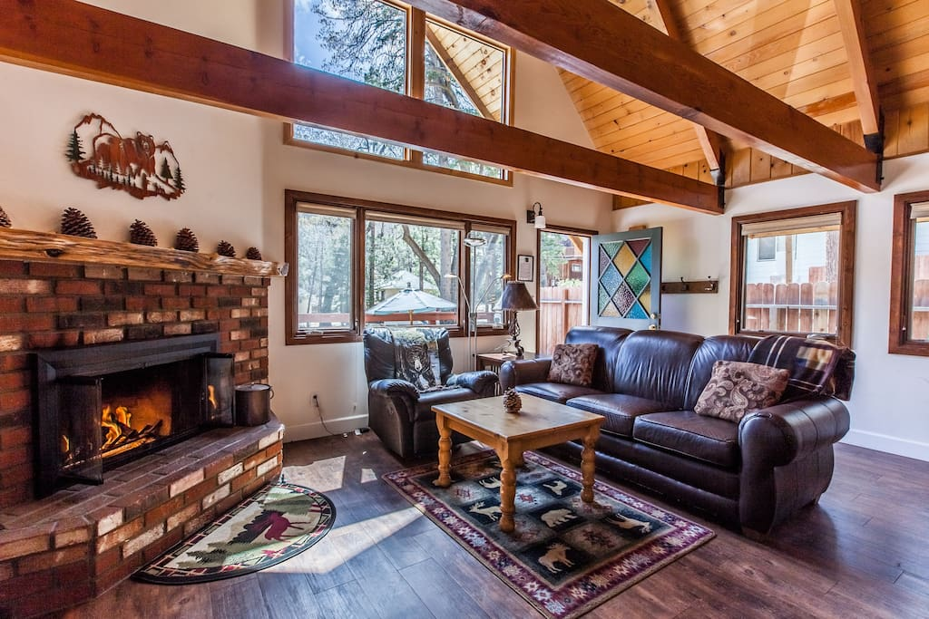 Living room with classic wood beams, hardwood floor, vaulted ceiling and soaring windows. HDTV Roku for access to Netflix and dozens of channels. DVD player and high speed WiFi.