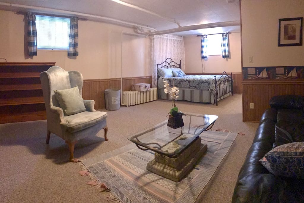 A panoramic view of the room, and the kitchenette is across from the bed, not captured in this photo.