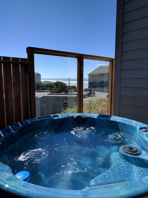 Relax in the 6 person hot tub while watching the whales