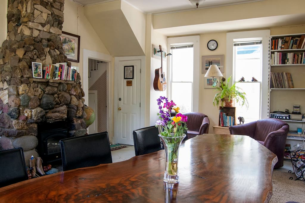 The focal point of the Bridge Street Inn lounge is this one of kind table created by a redwood tree and Carl.