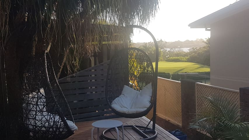 Guest timber deck sitting area with golf course and river views.