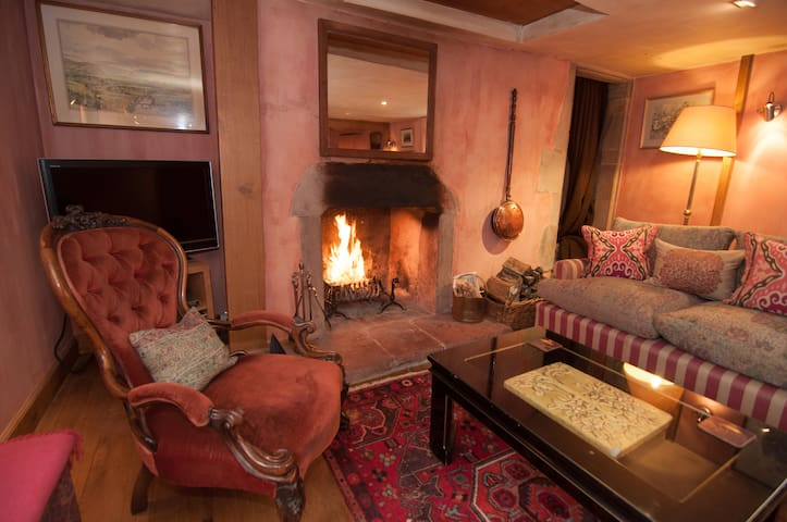 Sitting Room with roaring log fire