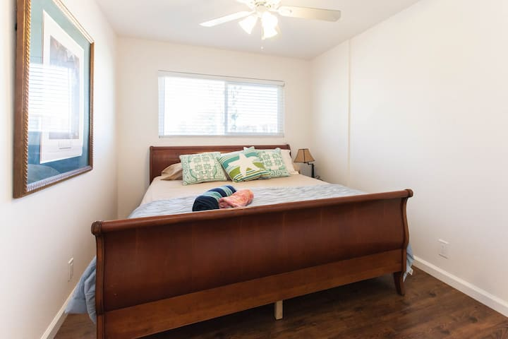 Master bedroom with lots of light and King bed