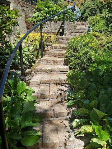 Cobblestone stairway leading to the private entrance
