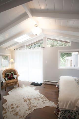 Queen bed; room opens to back garden