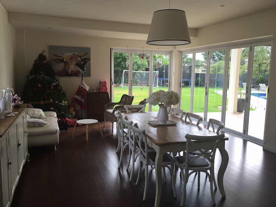 Dining room overlooking pool and garden