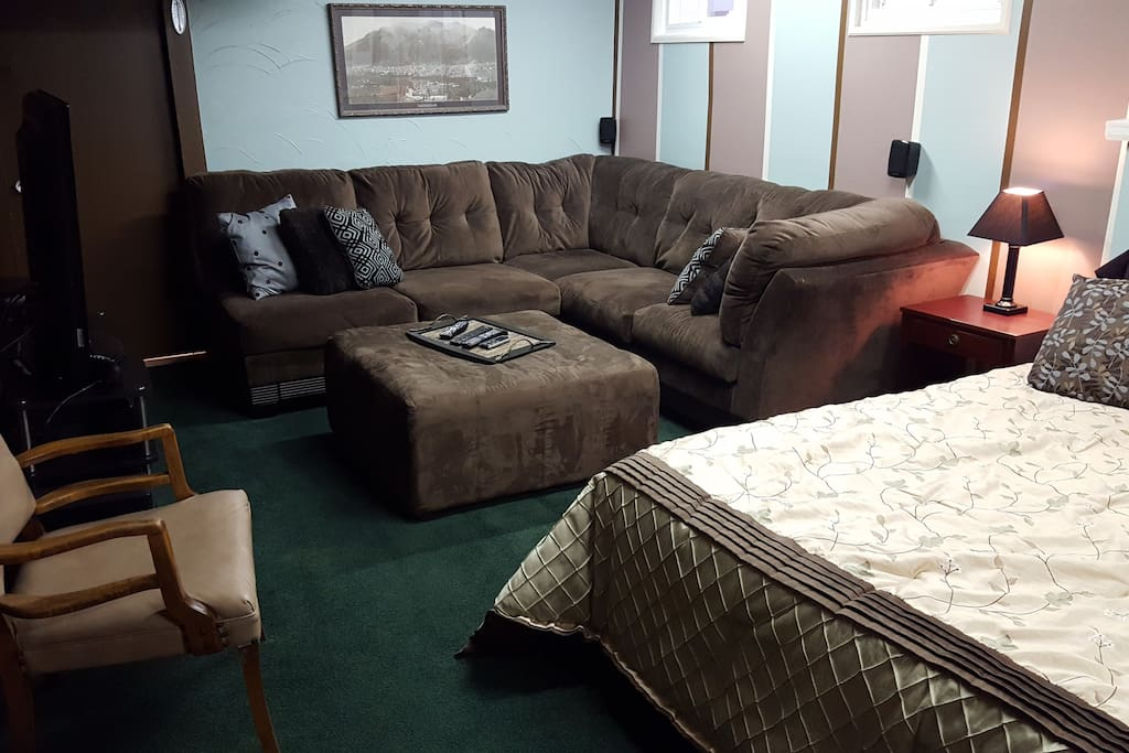 Wrap-around couch is sleeping area for 5th guest.