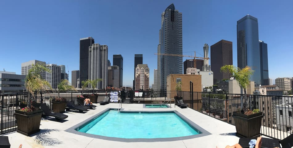 Rooftop pool and hot tub with the skyscrapers of LA!