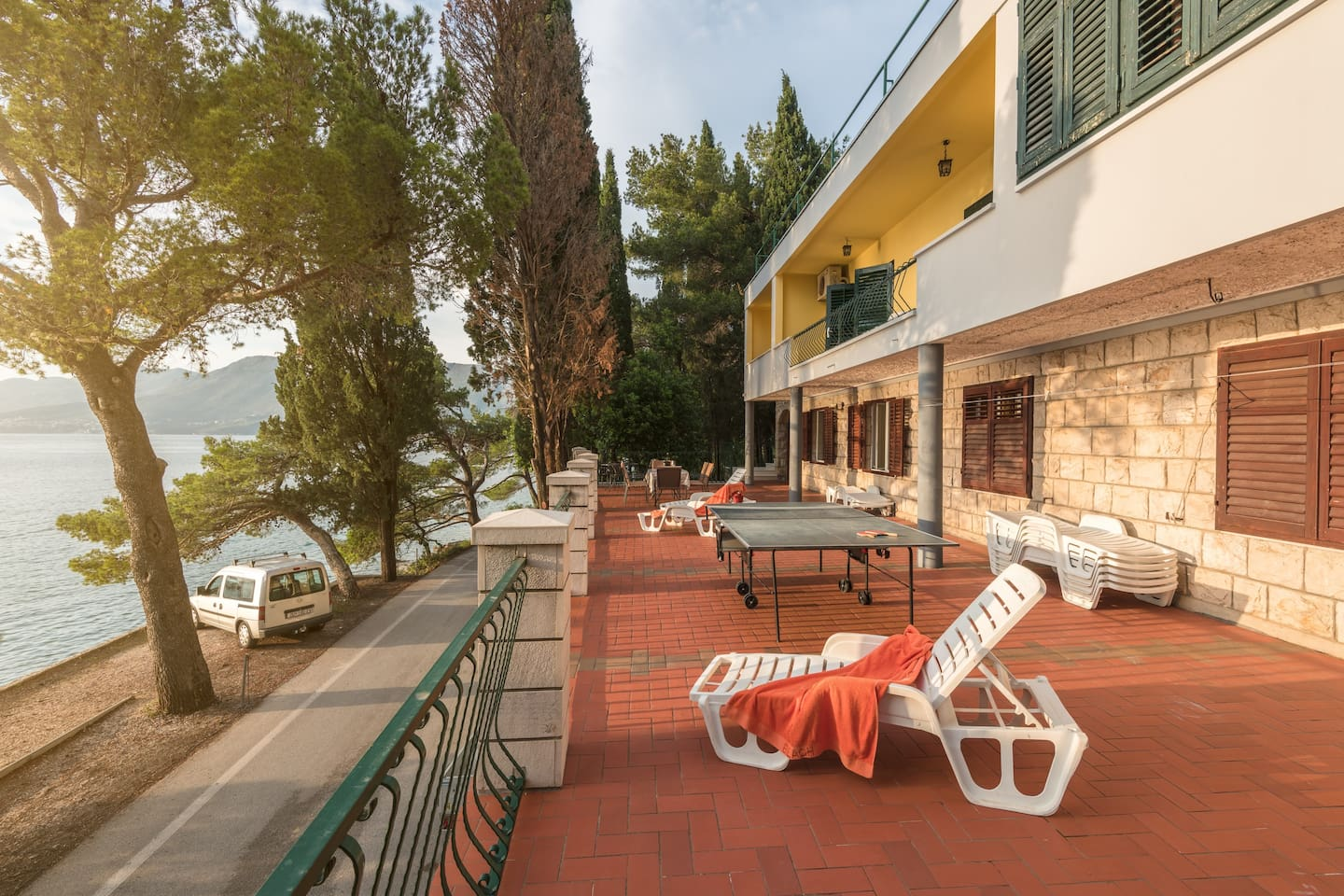 Terrace with sunbeds, table tennis, dining table