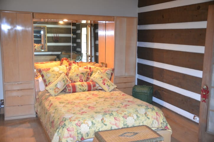 Master Bedroom with french doors to porch.