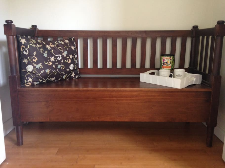 Indoor bench area with extra storage. Hair dryer, iron etc. are stored in this bench.