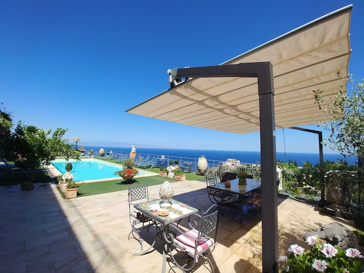 Sea View apartment with shared pool and garden