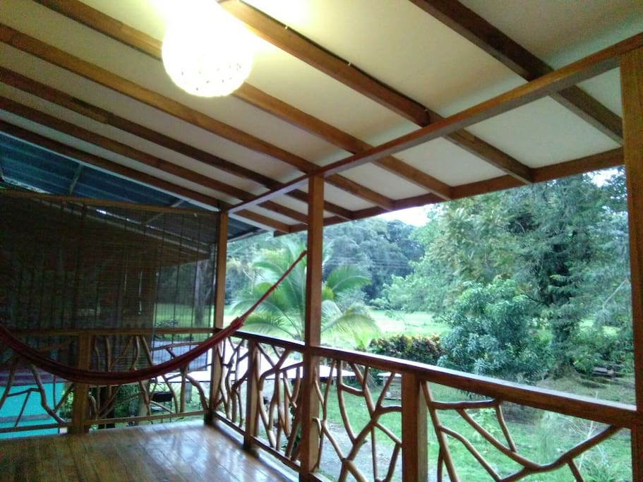Upstairs balcony with hammock and garden view