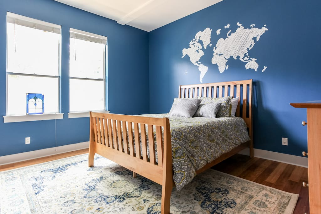 1 first bedroom with queen bed, dresser and full length mirror