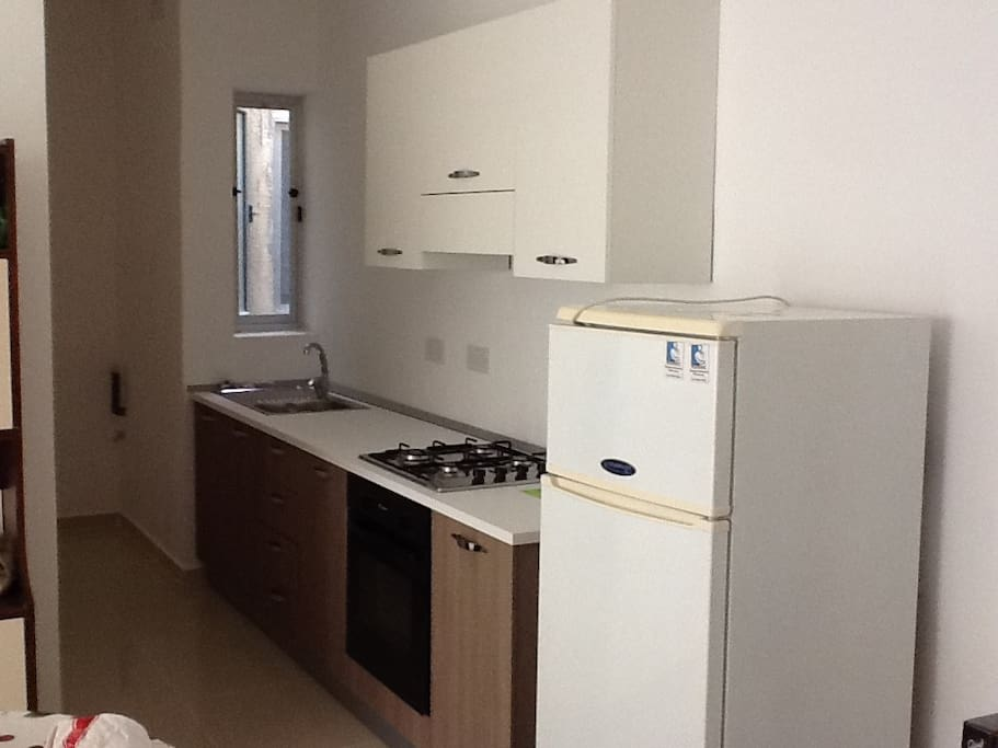 Brand new kitchen with all available utensils.