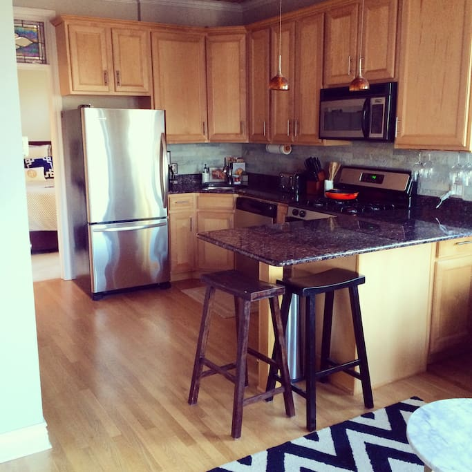 Granite countertops and stainless appliances. Kitchen is stocked with all the essentials to cook a great meal!