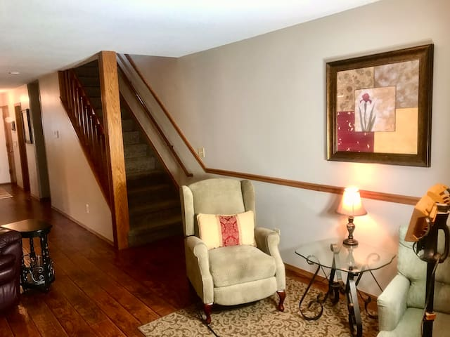 Stairs to bedrooms and seating area