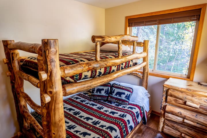 The bunk-beds are a double on the bottom and single on the top with Bear décor