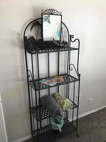 A little shelve you can use for folding clothes or else