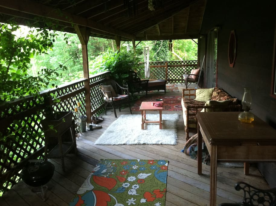 Relax  on the high porch off the back of the house.