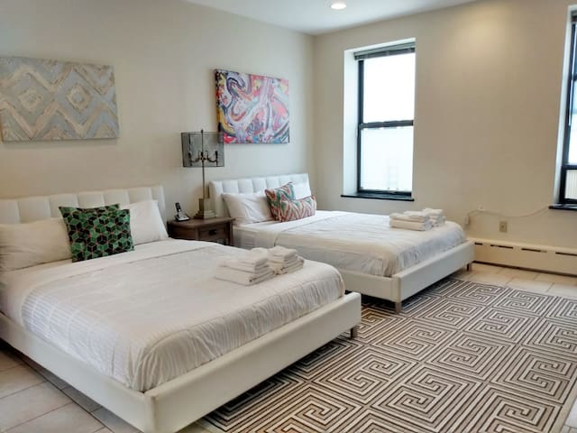 Master bedroom. Two queen beds, en suite bathroom