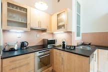 kitchen is fully equipped with nespresso machine, stove, oven , fridge , dishwasher and much more